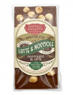 Bar of milk chocolate with whole hazelnuts
